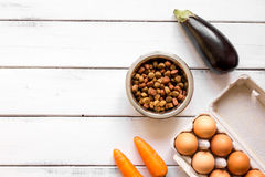 Ingredients for pet food holistic top view on wooden background Stock Images
