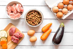 Ingredients for pet food holistic top view on wooden background Royalty Free Stock Photos