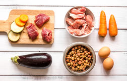 Ingredients for pet food holistic top view on wooden background Royalty Free Stock Image