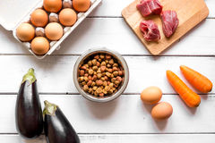 Ingredients for pet food holistic top view on wooden background Stock Image