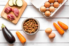 Ingredients for pet food holistic top view on wooden background Royalty Free Stock Photography