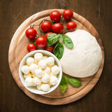 Ingredients for pizza margherita on wooden plate Royalty Free Stock Photography
