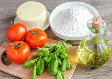Ingredients for pizza on the wooden background Stock Images