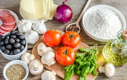 Ingredients for pizza on the wooden background Stock Image