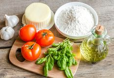 Ingredients for pizza on the wooden background Stock Photos
