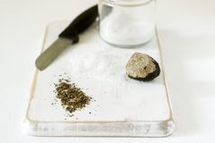 Ingredients for preparation of truffle salt, truffle and salt on a white background. Rustic style. stock photos
