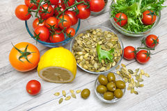 Ingredients for preparation of vegetable salad on a wooden backg Royalty Free Stock Images