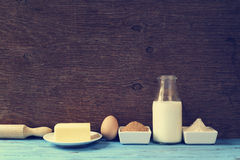 Ingredients for preparing cookies or a cake, retro effect. Some ingredients for preparing cookies or a cake, such as milk, eggs, flour, butter and brown sugar on Royalty Free Stock Photography