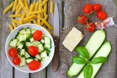 Ingredients for preparing Italian pasta dish. Top view Stock Photos