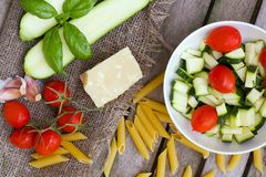 Ingredients for preparing Italian pasta dish. Top view Royalty Free Stock Photos