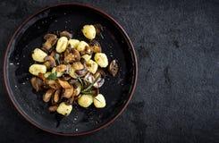 Ingredients for preparing mushrooms and gnocchi dish Royalty Free Stock Photo