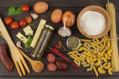 Ingredients for preparing pasta. Cooking pasta dishes. A traditional dish of pasta. Healthy diet meals Stock Photography