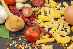 Ingredients for preparing pasta. Cooking pasta dishes. A traditional dish of pasta. Healthy diet meals Royalty Free Stock Image