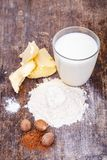 Ingredients for preparing white bechamel sauce on wooden table. Close up royalty free stock photography