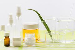 Ingredients for production of natural beauty cosmetics, close-up. Ingredients for production and packaging of natural beauty cosmetics, aloe vera lief stock photo