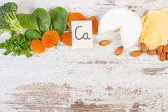 Products containing calcium and dietary fiber, healthy nutrition, copy space for text on old board. Ingredients or products containing calcium and dietary fiber Royalty Free Stock Photography