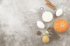 Ingredients for pumpkin pie - flour, pumpkins, eggs, cane sugar, Royalty Free Stock Images