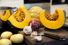 Ingredients for Pumpkin Soup. On a kitchen bench Stock Photo