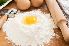 Ingredients for ravioli - flour, egg, spinach Stock Photo