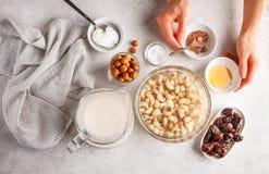 Ingredients for raw vegan cake, cashew cake on a white background. Ingredients for raw vegan cake, cashew cake on a white background, flat lay. Plant based dit royalty free stock image