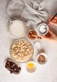 Ingredients for raw vegan cake, cashew cake on a white background. Ingredients for raw vegan cake, cashew cake on a white background, flat lay. Plant based dit stock photo