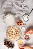 Ingredients for raw vegan cake, cashew cake on a white background. Ingredients for raw vegan cake, cashew cake on a white background, flat lay. Plant based dit royalty free stock photos