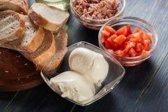 Ingredients ready for preparing bruschetta with tuna, mozzarella Stock Images