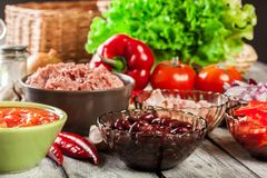 Ingredients ready for preparing chili con carne. Mincemeat, papr Stock Photos
