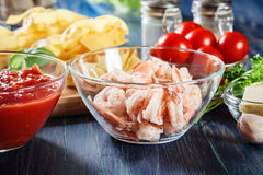 Ingredients ready for preparing pappardelle pasta with shrimp, tomatoes and herbs Royalty Free Stock Images