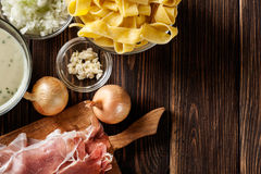 Ingredients ready for preparing pappardelle with prosciutto and Stock Image