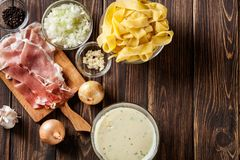 Ingredients ready for preparing pappardelle with prosciutto and. Cheese sauce. Food and drink. Top view Royalty Free Stock Photos