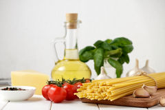 Ingredients for recipe of italian pasta dish on white background. stock photo