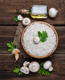 Ingredients for risotto: rice, mushroom, garlic, oil Royalty Free Stock Photos