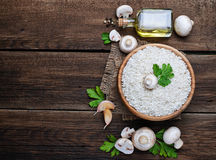 Ingredients for risotto: rice, mushroom, garlic, oil Royalty Free Stock Image