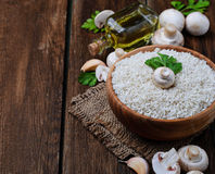 Ingredients for risotto: rice, mushroom, garlic, oil Stock Photography