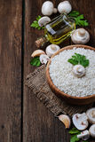 Ingredients for risotto: rice, mushroom, garlic, oil Royalty Free Stock Images