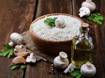 Ingredients for risotto: rice, mushroom, garlic, oil Royalty Free Stock Photo