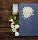 Ingredients for risotto: rice, mushroom, garlic, oil Stock Photo