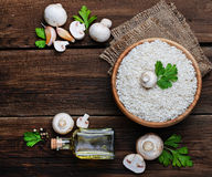 Ingredients for risotto: rice, mushroom, garlic, oil Stock Image