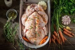 Ingredients for roasted chicken with vegetables and herbs. On wooden table Stock Photo