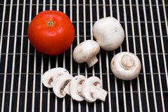 Ingredients for salad. Fresh mushrooms and tomato salad Royalty Free Stock Images