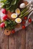 Ingredients for the salad: egg, sorrel, tomato, radish Royalty Free Stock Photo