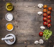 Ingredients  salad, oil, cherry tomatoes, lettuce, spices wooden rustic background top view close up place for text,fram Stock Photos