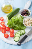 Ingredients for salad with tomatoes cucumber olives and feta che Royalty Free Stock Photography