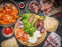 Ingredients for Sandwich making: roasted meat, vegetables and sweet potatoes Stock Images