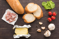 Ingredients for sandwich with smoked meat, baguette on wooden ba Stock Image