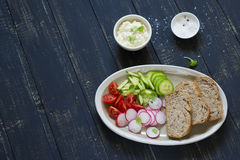 ingredients for sandwiches with cheese, egg, cucumber, radish and cherry tomatoes Royalty Free Stock Image