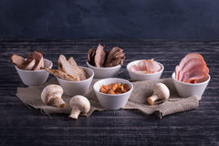 Ingredients for sauce or dish. Cheese, Mushrooms, Fish, Meat Royalty Free Stock Photography