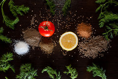 Ingredients and seasoning for healthy vegetarian cooking on black background. Diet or vegan food concept. Top view. royalty free stock photography