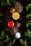 Ingredients and seasoning for healthy vegetarian cooking on blac. The composition of the food. Ingredients and seasoning for healthy vegetarian cooking on black Royalty Free Stock Photography